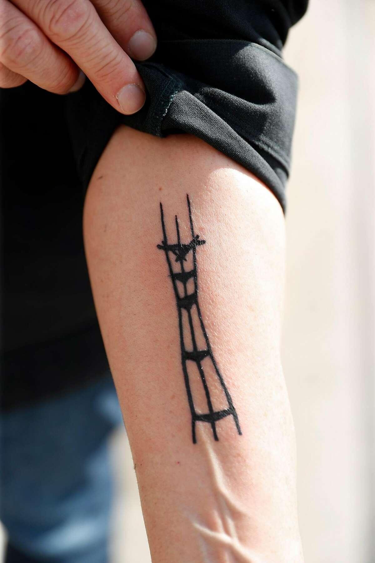 Alabama history professor Gordon Harvey shows his Sutro Tower tattoo while touring City Hall in San Francisco, Calif., on Thursday, February 20, 2020.