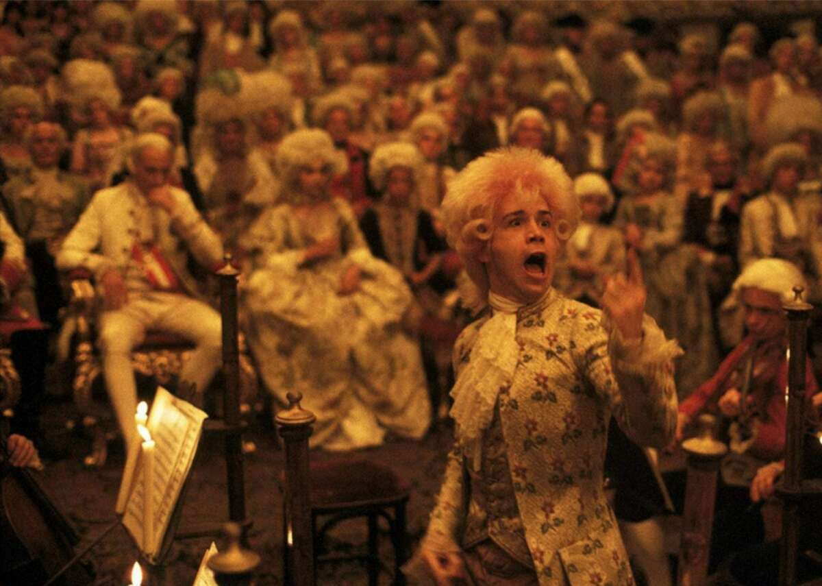 """#100. Amadeus (1984) - Director: Milos Forman - Stacker score: 89.1 - Metascore: 88 - IMDb user rating: 8.3 - Runtime: 160 minutes Winner of eight Academy Awards, including Best Picture, this 1984 biopic chronicles the life of Amadeus Mozart, namely through the eyes of his bitter contemporary, Antonio Salieri. Striving for authenticity, director Milos Forman shot the film using only natural light, arguably taking some cues from Stanley Kubrick, who did the same when making """"Barry Lyndon."""" To prepare for his role as the famous composer, actor Tom Hulce practiced piano for four-to-five hours a day before filming began."""