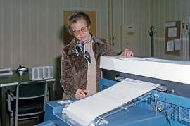 """FILE -- A photo provided by NASA shows Katherine Johnson at work at NASA's Langley Research Center in Hampton, Va., in 1980.  Johnson, one of a group of black women mathematicians at NASA and its predecessor who were celebrated in the 2016 movie """"Hidden Figures,"""" died on Monday, Feb. 24, 2020, in Newport News, Va. She was 101. (NASA via The New York Times) **EDITORIAL USE ONLY**"""
