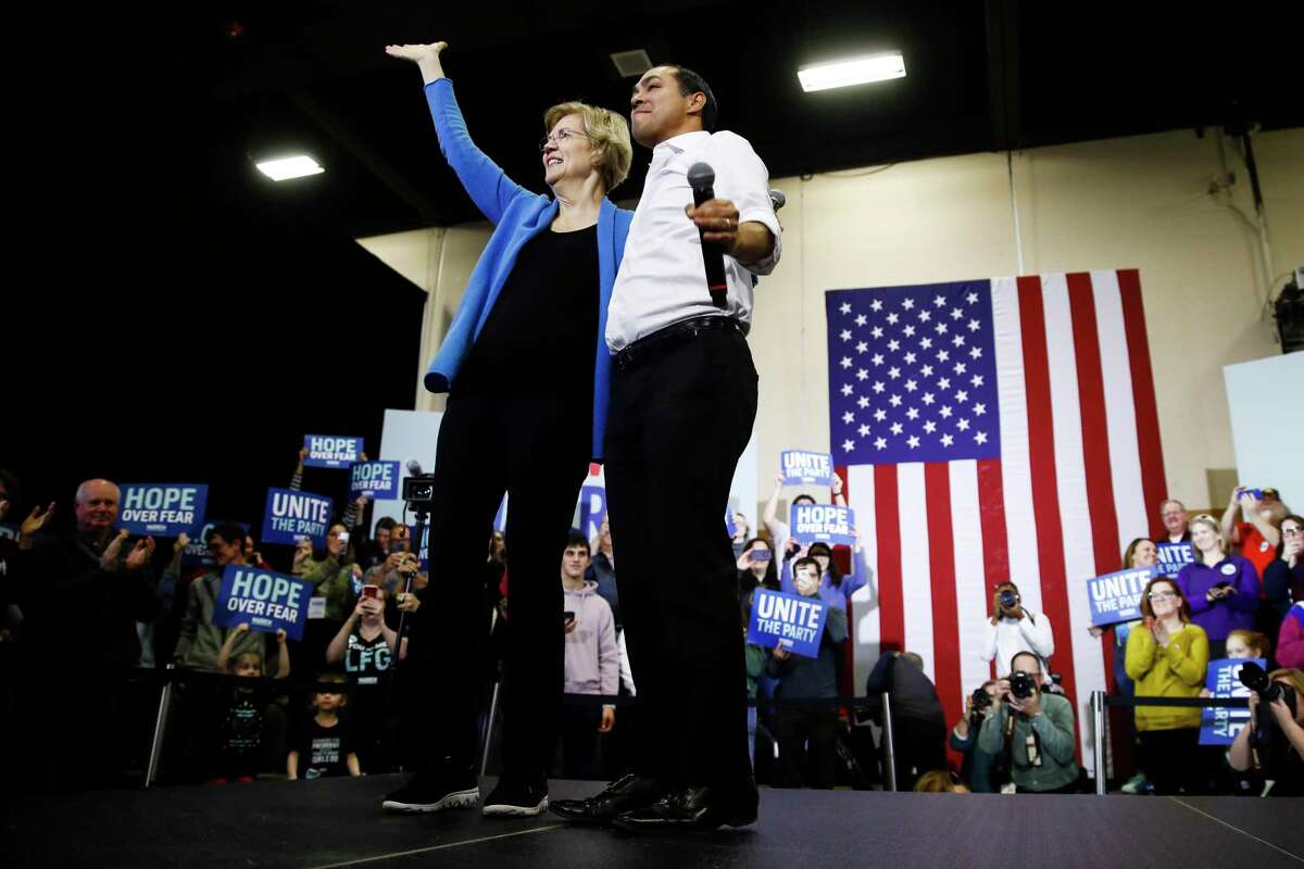 Democratic presidential candidate Sen. Elizabeth Warren, D-Mass., stands with Julian Castro, right, former Secretary of Housing and Urban Development, during a campaign event, Saturday, Feb. 1, 2020, in Davenport, Iowa.