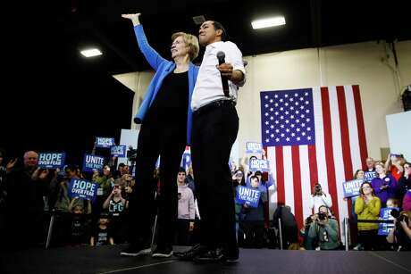 Democratic presidential candidate Sen. Elizabeth Warren, D-Mass., stands with Julian Castro, right, former Secretary of Housing and Urban Development, during a campaign event, Saturday, Feb. 1, 2020, in Davenport, Iowa. (AP Photo/Matt Rourke)