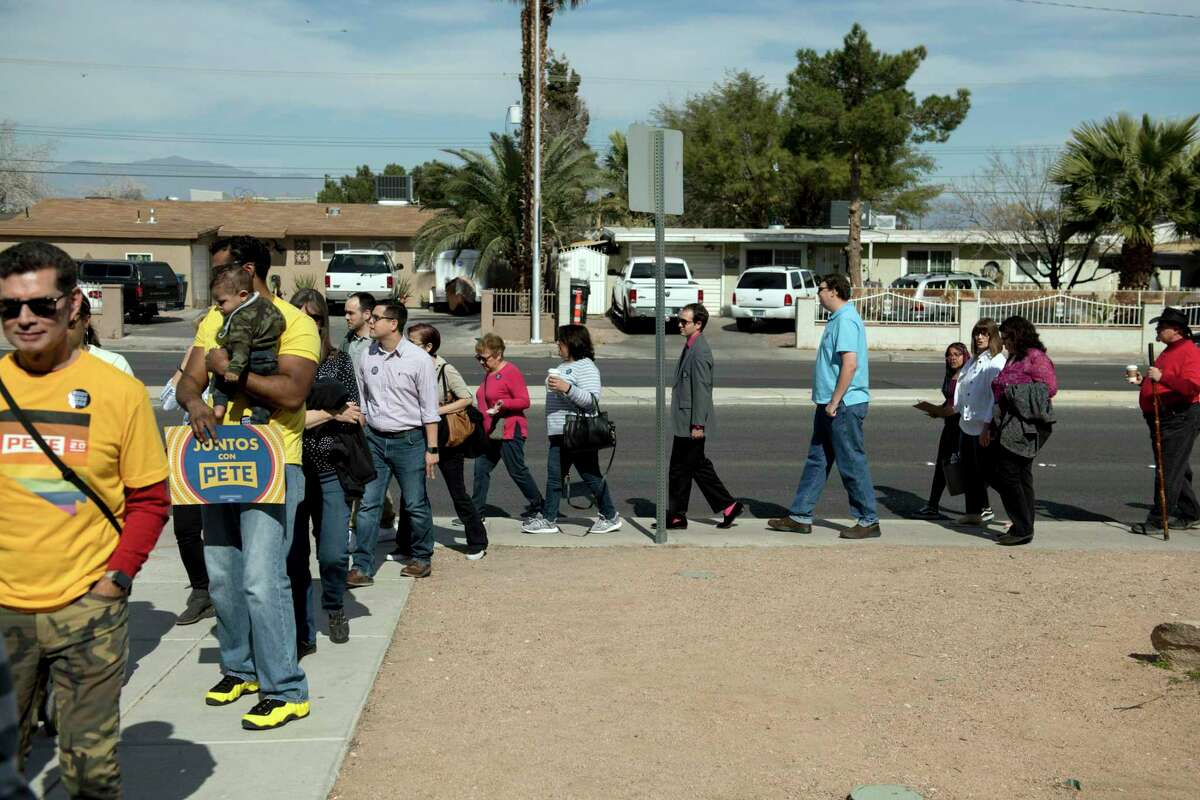 Supporters wait in line to enter a campaign rally for Pete Buttigieg, a Democratic candidate for president, in Las Vegas on Sunday, Feb. 16, 2020. A Telemundo poll of likely Latino caucusgoers in Nevada listed him as a distant third to Sen. Bernie Sanders (I-Vt.) and former Vice President Joe Biden.