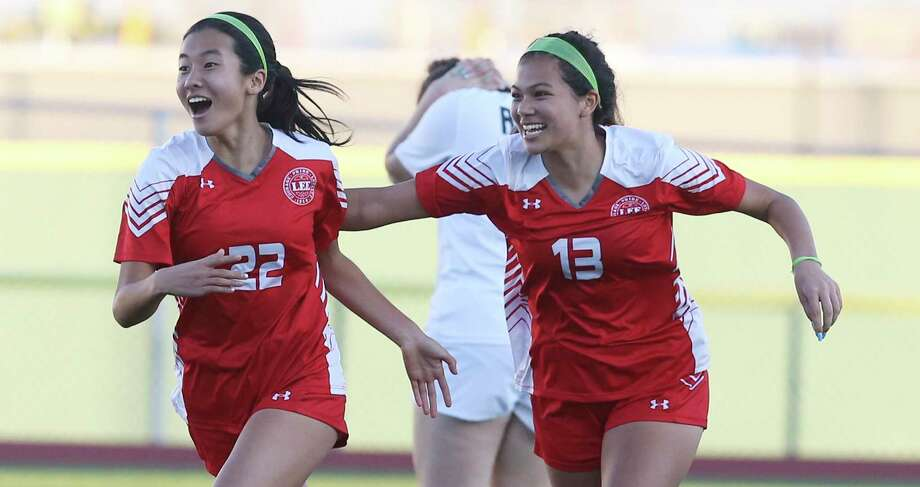LEE's Kyleena Xin (22) celebrates with teammate Isela Zertuche (13) after Xin scores in the second half against Reagan during their girls soccer game at Commander Stadium on Wednesday, Feb. 12, 2020. LEE defeated Reagan, 1-0, on Xin's score. Photo: Kin Man Hui /Staff Photographer / **MANDATORY CREDIT FOR PHOTOGRAPHER AND SAN ANTONIO EXPRESS-NEWS/NO SALES/MAGS OUT/ TV OUT