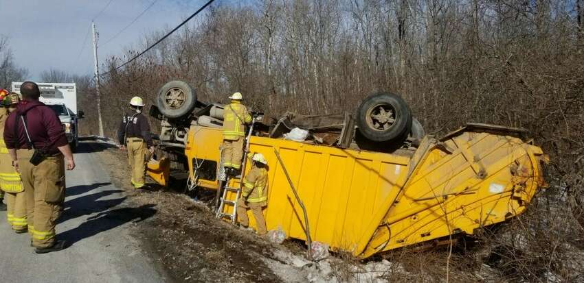 Doug Vogel of Rensselaerville lost control of his garbage truck which went off Saw Mill Road in Berne, N.Y. Monday Feb. 24, 2020 and flipped over, the Albany County Sheriff's Office reported.