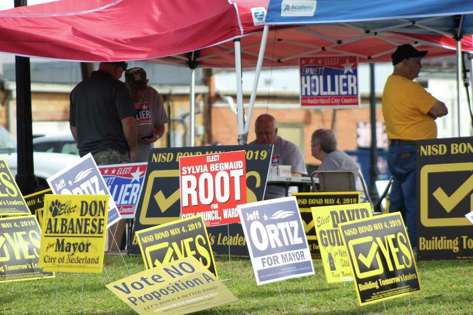 Signs at the Nederland City Hall on Saturday May 4th during voting. Photo: Photo By: Erica Apodaca/The Enterprise