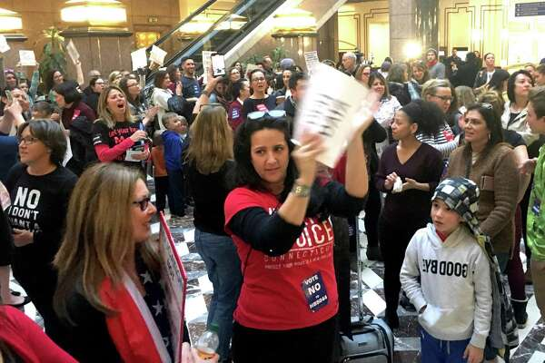 Opponents of a bill that would repeal the religious exemptions from mandatory vaccinations packed the Legislative Office Building in Hartford.