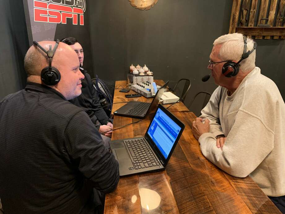 Northwood tennis coach Zane Colestock (right) joins Northwood Sports Information Director Travis McCurdy (left) and ESPN 100.9's Brad Tunney (background) on the air for the weekly Northwood Coaches Show on Monday at Molasses Smokehouse & Bar in Midland. Photo: Fred Kelly/fred.kelly@mdn.net