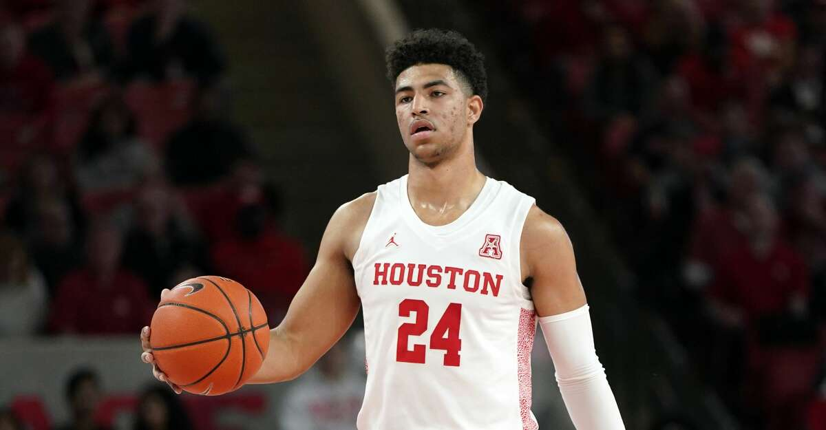 Houston's Quentin Grimes (24) brings the ball up the court against Tulsa during the first half of an NCAA college basketball game Wednesday, Feb. 19, 2020, in Houston. (AP Photo/David J. Phillip)