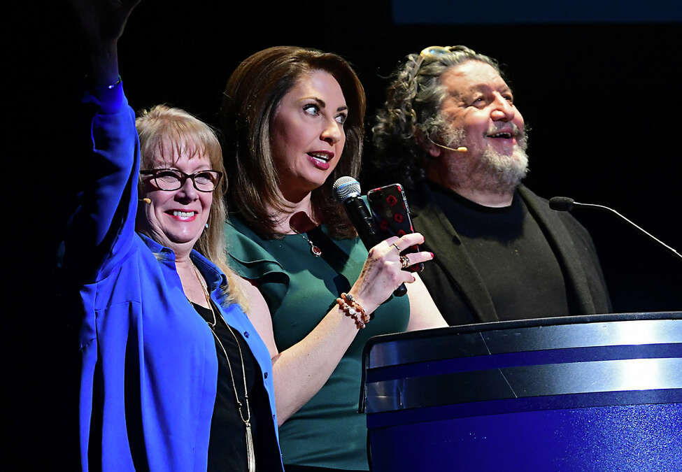 From left, Maggie Mancinelli-Cahill, producing artistic director at Capital Repertory Theatre, News 10 anchor Lydia Kulbida and Philip Morris, CEO of Proctors talks to the audience as Proctors and Capital Repertory Theatre announce their 2020-2021 season offerings in their annual bash at Proctors on Monday, Feb. 24, 2020 in Schenectady, N.Y. (Lori Van Buren/Times Union)