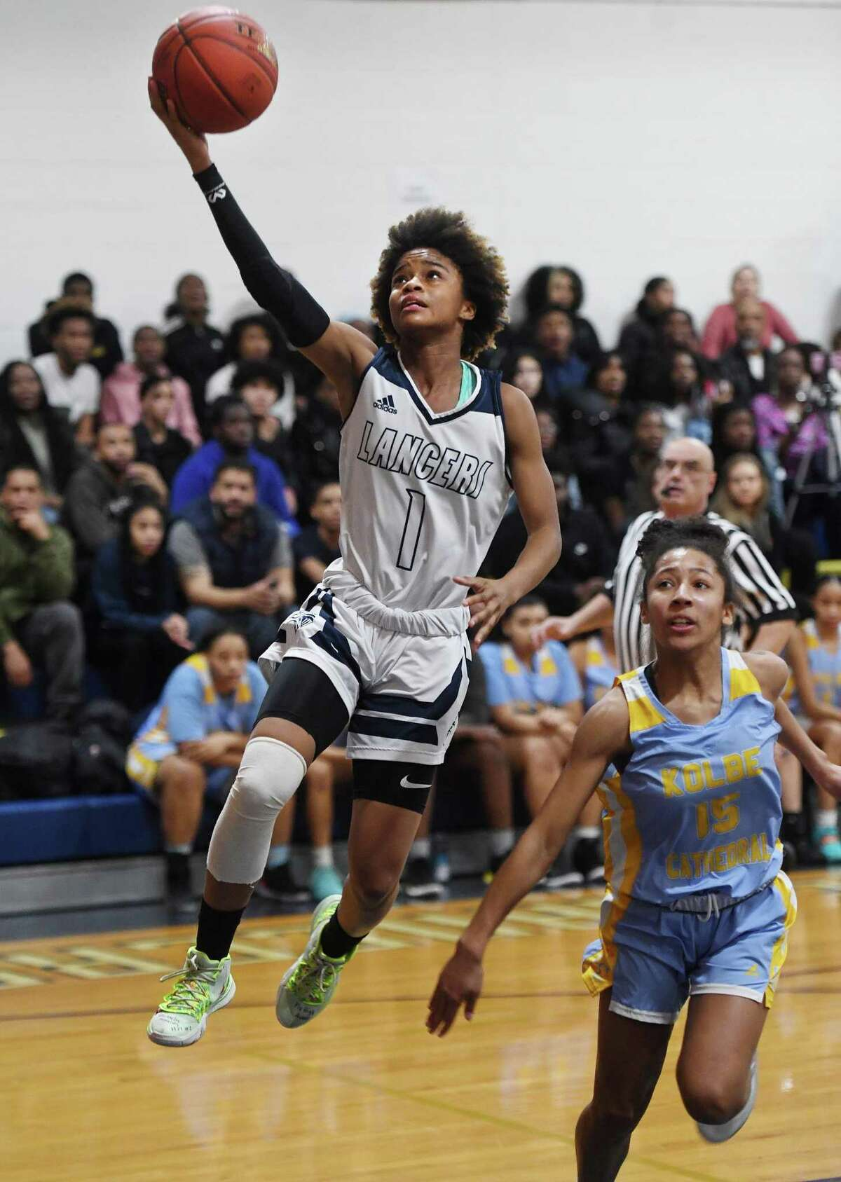 Notre Dame of Fairfield's Yamani McCollough soars to the basket ahead of Kolbe Cathedral defender Aniyah Pettway in the first half of the SWC girls basketball semifinals at Notre Dame High School in Fairfield, Conn. on Monday, February 24, 2020.
