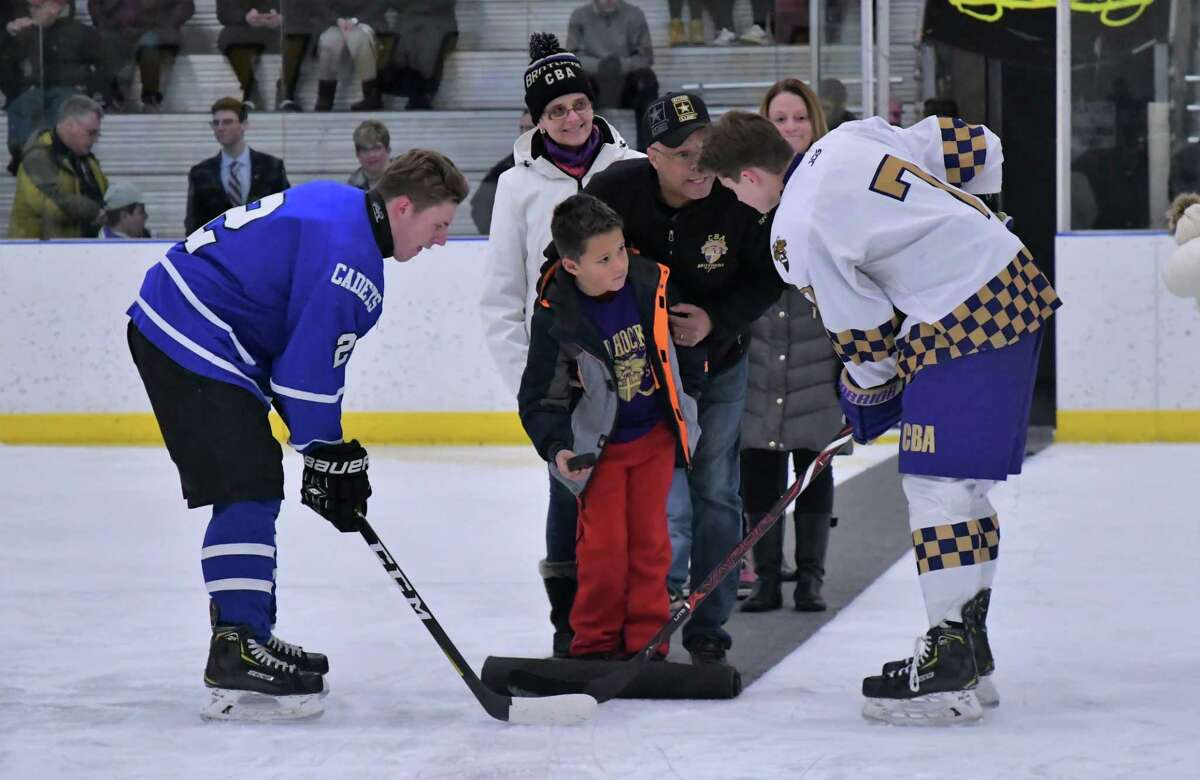 CBA and La Salle perform the ceremonial faceoff in front of the Reeves and Fingerhut families. (Courtesy of Loni Herman)