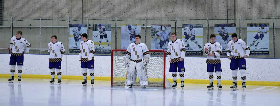 CBA seniors, from left, Dale Hammond, Mike West, Colin Mesick, Josh Coburn, Jake Woodruff, Sean Swenson and Mike Cochran are recognized before the Senior Nigh game against La Salle. (Courtesy of Loni Herman)