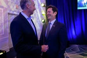 USAA's new CEO, Wayne Peacock, right, is greeted by his predecessor, Stuart Parker, during a reception at the Sheraton Gunther Hotel on Monday. Parker retired as CEO of the insurance giant last month.
