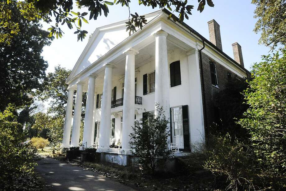 The Magnolia Grove, a state-owned antebellum plantation home in Greensboro, Ala., has a slave cabin that tourists can visit, yet its 1972 entry on the National Register doesn't mention slaves. Photo: Jay Reeves / Associated Press