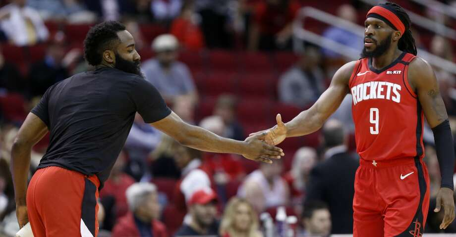Houston Rockets guard James Harden, left, slaps hands with forward DeMarre Carroll (9) as he comes off the court during a time out during the first half of an NBA basketball game against the New York Knicks on Monday, Feb. 24, 2020, at Toyota Center in Houston. Photo: Brett Coomer/Staff Photographer