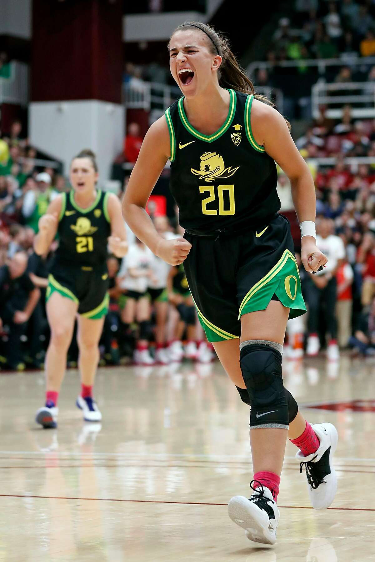 """Oregon""""s Sabrina Ionescu celebrates after a Duck basket and foul against Stanford during Pac 12 women's basketball game at Maples Pavilion in Stanford, Calif., on Monday, February 24, 2020."""