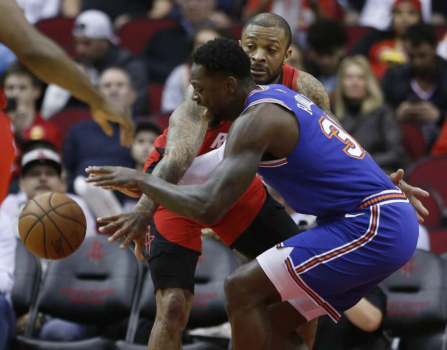 Houston Rockets forward P.J. Tucker knocks the ball away from New York Knicks forward Julius Randle (30) during the first half of an NBA basketball game on Monday, Feb. 24, 2020, at Toyota Center in Houston. Photo: Brett Coomer/Staff Photographer