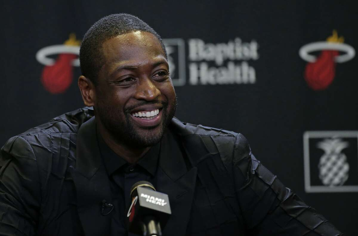 Former Miami Heat guard Dwyane Wade speaks to the media after his ceremony for his jersey retirement at halftime as the Heat host the Cleveland Cavaliers on Saturday, Feb. 22, 2020 at AmericanAirlines Arena in Miami, Fla. (David Santiago/Miami Herald/TNS)