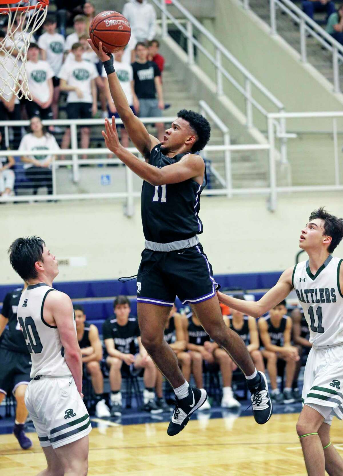 Kino Rodriguez-Thompson gets to the lane for a layup as Warren plays Reagan in boys basketball playoff action at Taylor Field House on Feb. 24, 2020.