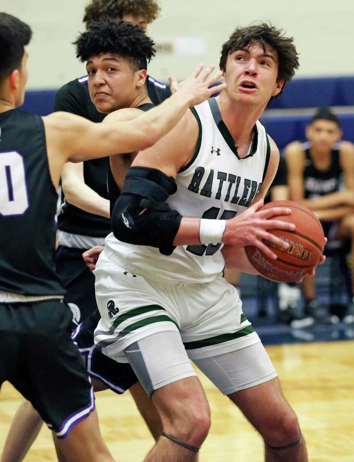 Reagan's Will Carsten pivots to get off a shot under the hoop against Warren in boys basketball playoff action at Taylor Field House on Feb. 24, 2020.