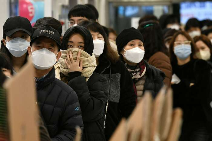 People wait in a line to buy face masks at a retail store in the southeastern city of Daegu on February 25, 2020. - South Korea reported 60 more COVID-19 coronavirus cases on February 25, the smallest increase for four days in the Korea Centers for Disease Control and Prevention's morning updates. The country now has 893 cases. (Photo by Jung Yeon-je / AFP) (Photo by JUNG YEON-JE/AFP via Getty Images)