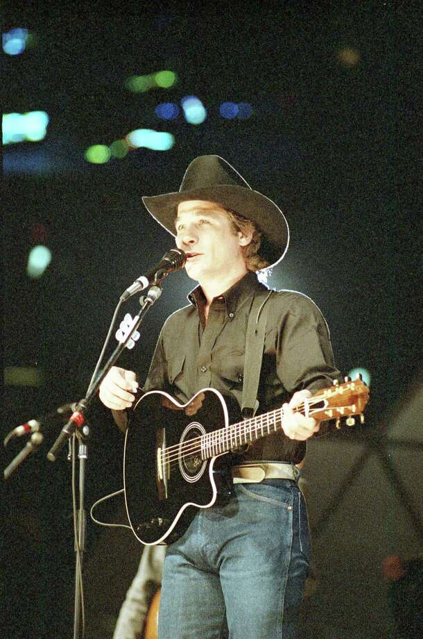 Katy native Clint Black, who used to sing for free at picnic tables in Bear Creek Park, proved his star power Sunday, Feb. 18, 1990, with a record sellout crowd in the Astrodome. Photo: Richard Carson, Houston Chronicle