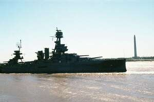 The USS Texas makes its way from Todd Shipyards in Galveston to Port at Greens Bayou, former site of Todd Shipyards, Feb. 23, 1990.