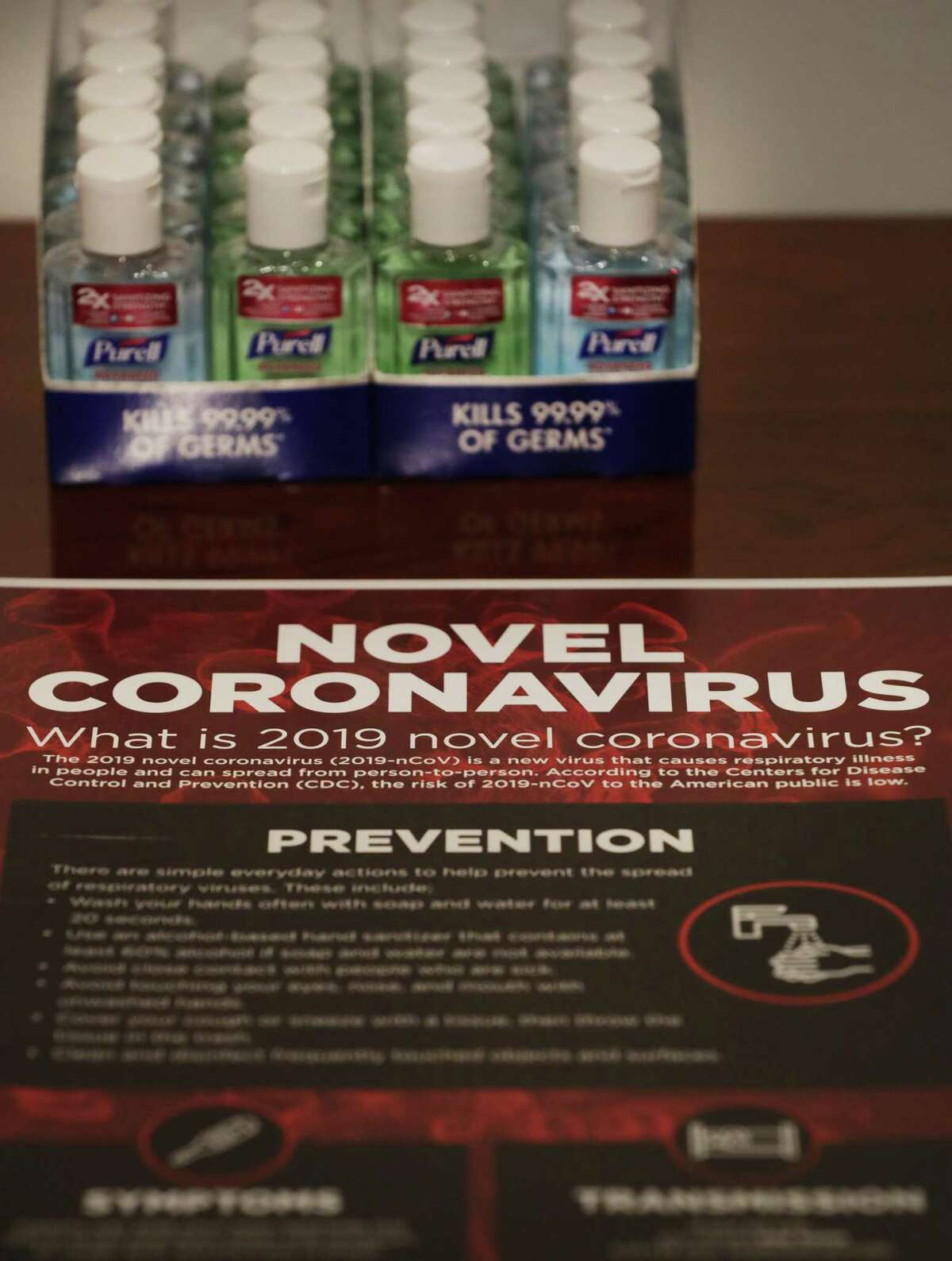 Small bottles of hand sanitizer and information about the novel coronavirus are displayed at a news conference where San Antonio officials answered questions about the coronavirus and the evacuees from a cruise ship who are under quarantine at Joint Base San Antonio-Lackland.