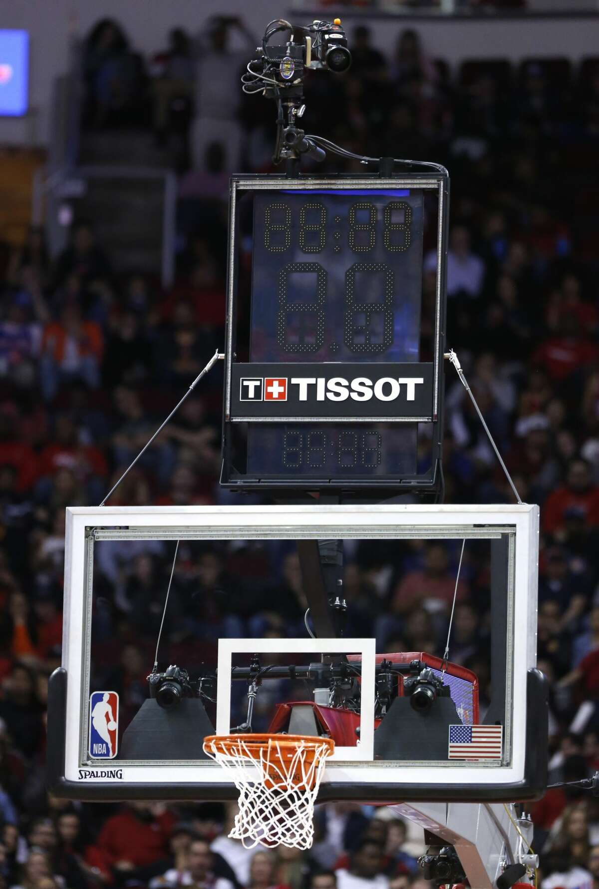 The clock above the basket was out during an NBA basketball game between the Houston Rockets and the New York Knicks on Monday, Feb. 24, 2020, at Toyota Center in Houston. A clock was placed on the floor during the game.