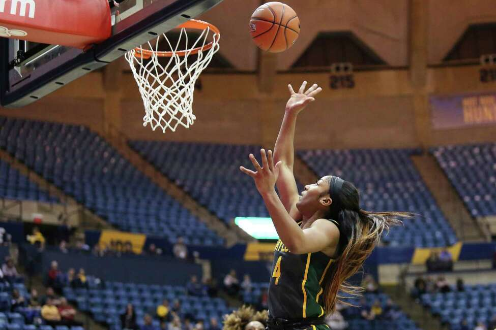Baylor guard Te'a Cooper (4) shoots during the first half of an NCAA college basketball game against West Virginia, Monday, Feb. 24, 2020, in Morgantown, W.Va. (AP Photo/Kathleen Batten)