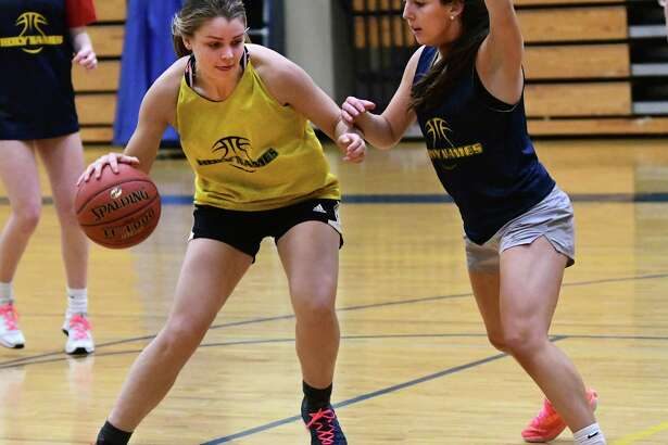 Holy Names senior basketball player Grace Field, left, is seen during practice on Monday, Feb. 24, 2020 in Albany, N.Y. (Lori Van Buren/Times Union)