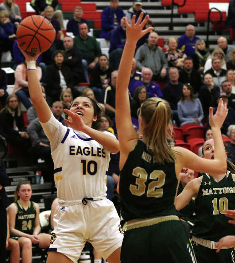 CM's Kourtland Tyus (10) puts up a shot over Mattoon's Hallie Niemerg during the first half Monday night in a semifinal at the Effingham Class 3A Sectional. Photo: Greg Shashack / The Telegraph