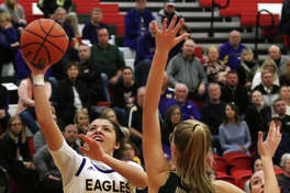 CM's Kourtland Tyus (10) puts up a shot over Mattoon's Hallie Niemerg during the first half Monday night in a semifinal at the Effingham Class 3A Sectional.