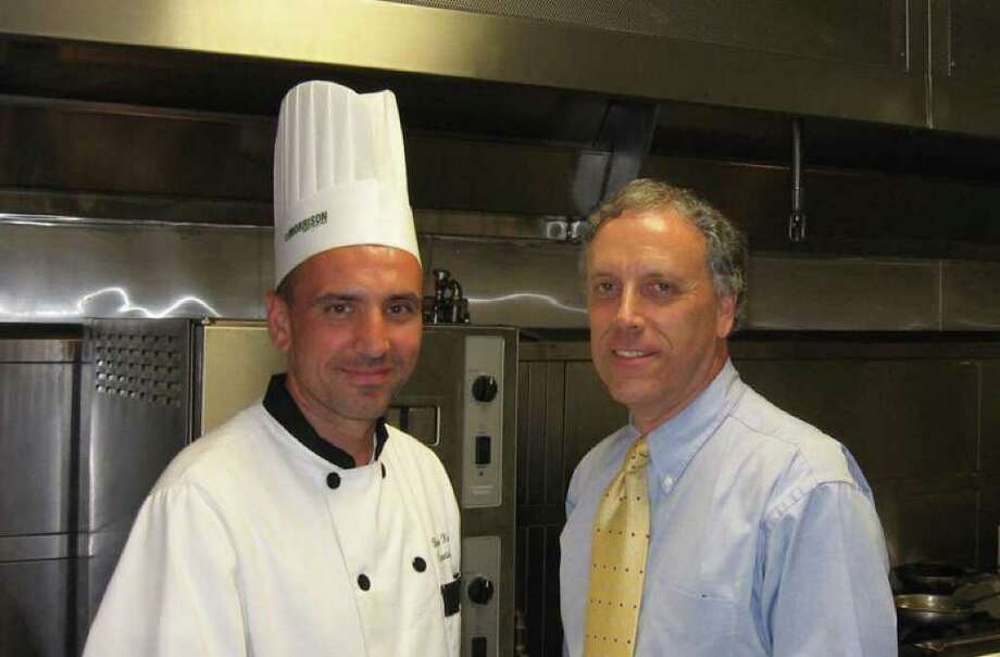 Executive Chef Brian Kirdzik, left, and Masonicare at Newtown President Thomas Gutner, right, will welcome professionals to one of 12 regional training centers in the country. Photo: Contributed Photo / The News-Times Contributed