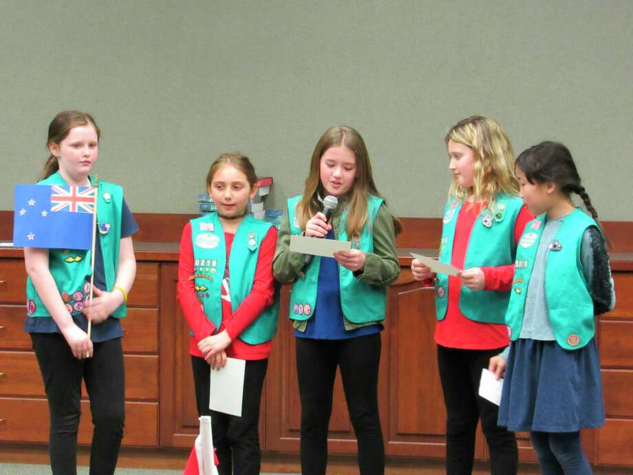 Girl Scout Troop 50219 presents information about Australia during a skit. Area Girl Scout troops gathered on Friday at Trinity Lutheran Church in Midland to celebrate World Thinking Day. (Victoria Ritter/vritter@mdn.net)