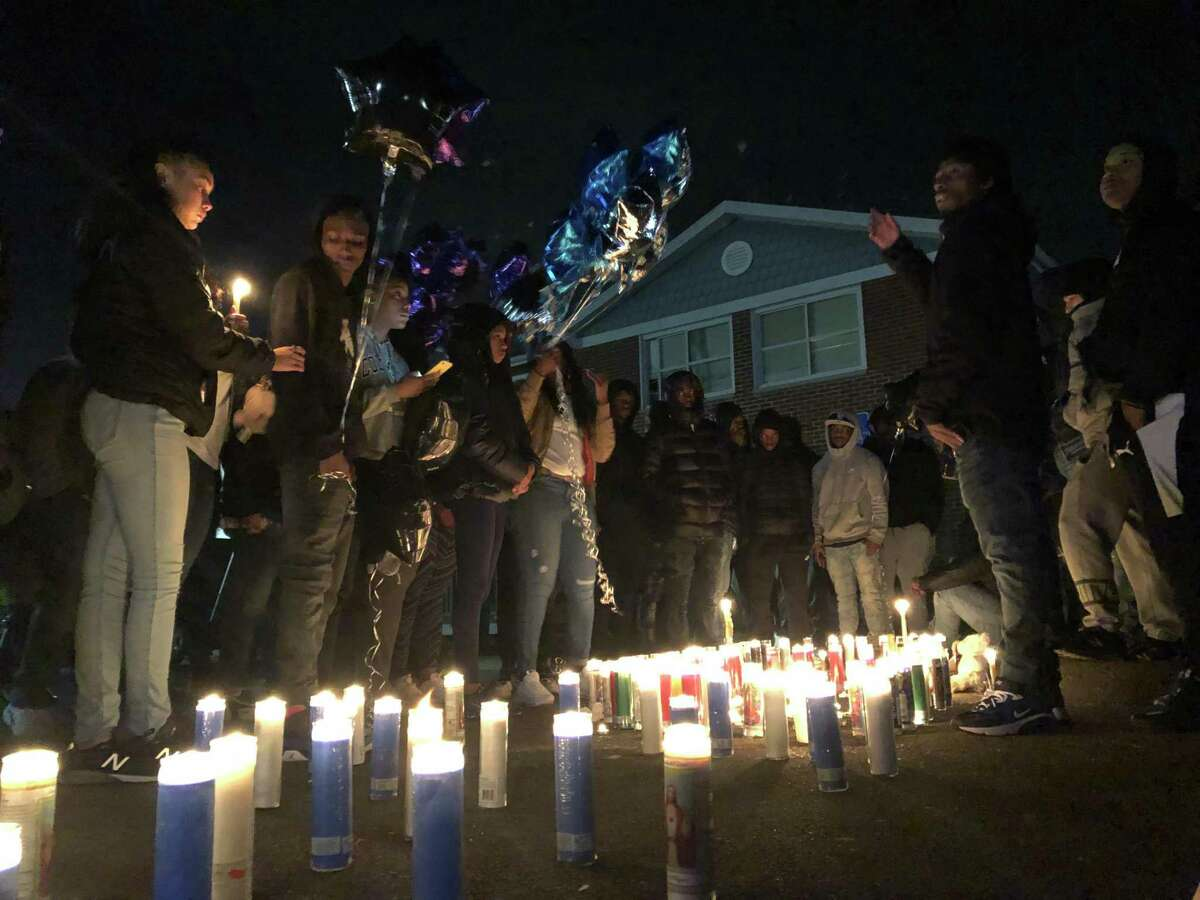 Residents gathered to honor Dashown Myers, 18, shot and killed on Quinnipiac Avenue in New Haven, with a vigil Monday night.