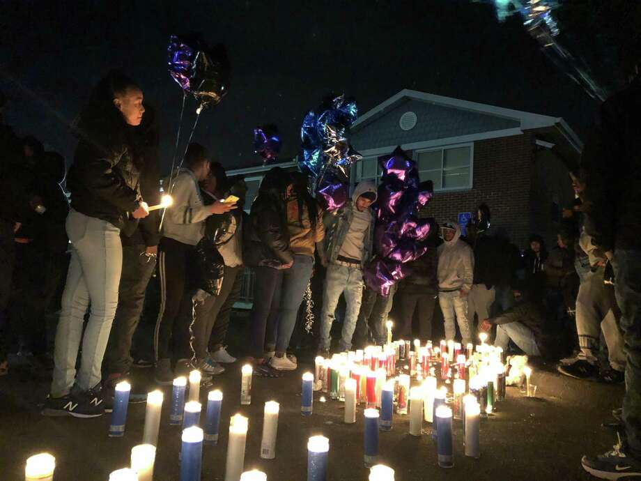 Residents gathered to honor Dashown Myers, 18, shot and killed on Quinnipiac Avenue in New Haven, with a vigil Monday night. Photo: Ben Lambert / Hearst Connecticut Media