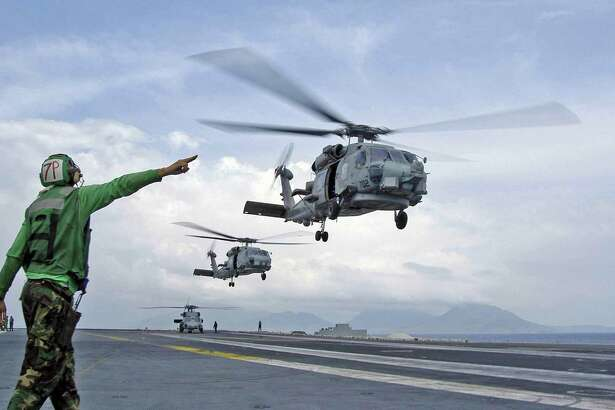 A file photo of Sikorsky Seahawk helicopters in action in Indonesia. (AP Photo/U.S. Navy photo)
