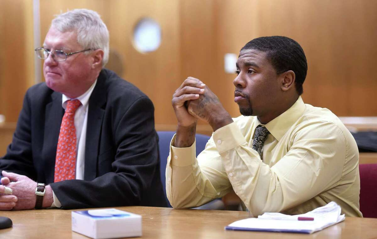 Joshua Council, right, appears in Superior Court in New Haven seated next to his attorney, Thomas Farver, on Feb. 24, 2020, on the first day of a trial in the murder of Kenneth Cooper.