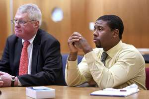 Joshua Council (right) appears in Superior Court in New Haven seated next to his attorney, Thomas Farver, on February 24, 2020 on the first day of a trial for the murder of Kenneth Cooper.