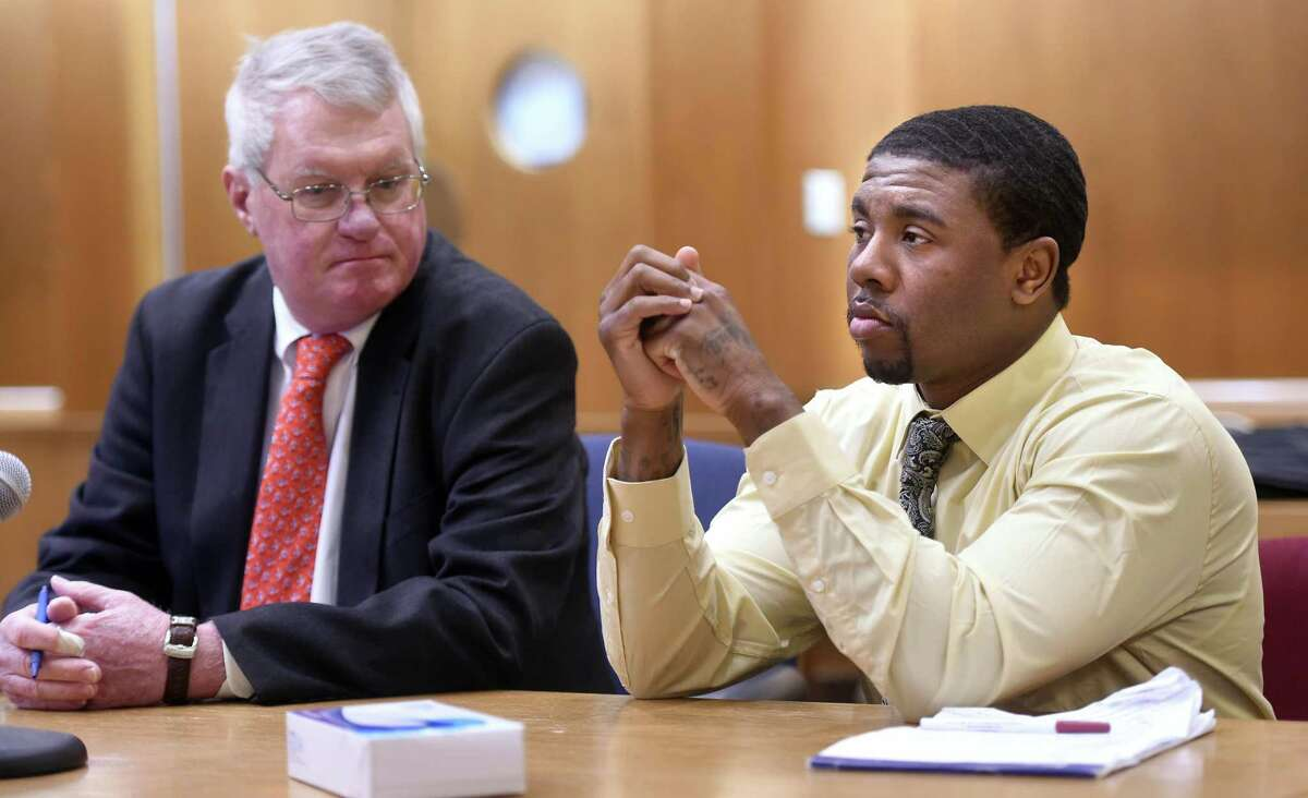 Joshua Council, right, appears in Superior Court in New Haven seated next to his attorney, Thomas Farver, on Feb. 24, 2020, the first day of a trial in the slaying of Kenneth Cooper.
