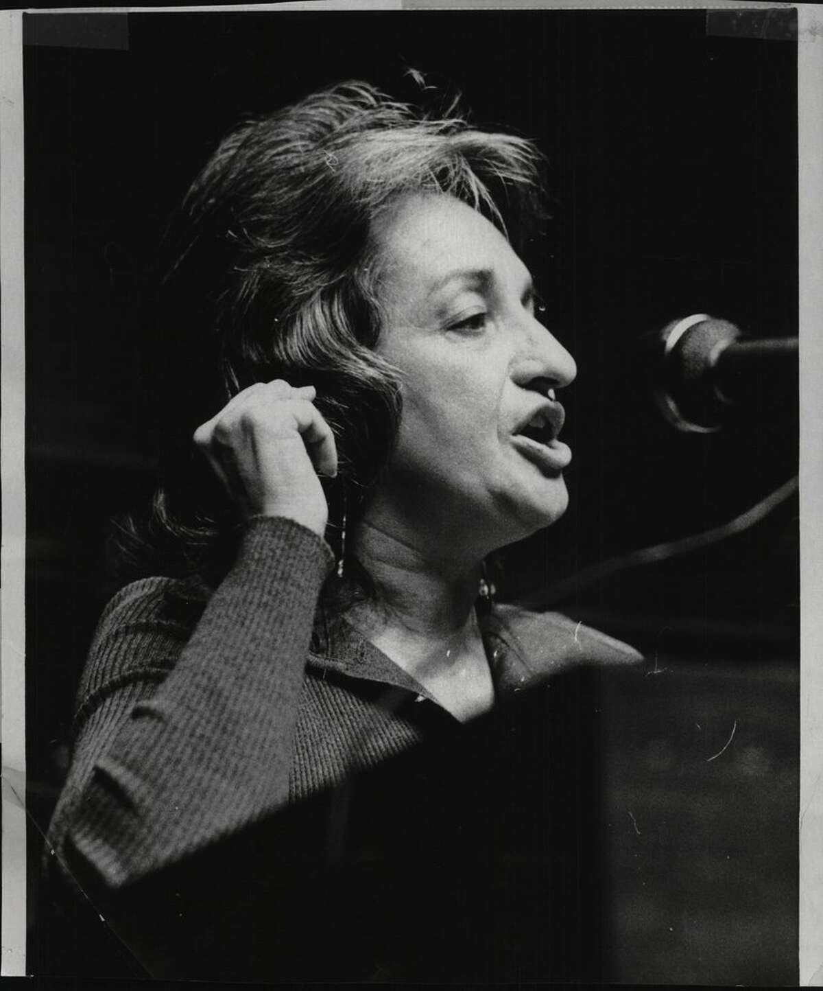 Women's rights activist Betty Friedan addresses a conference on