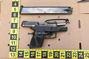 A .9 millimeter semiautomatic pistol with an illegal 32-bullet magazine found by police while searching a Severance Drive home on Friday.