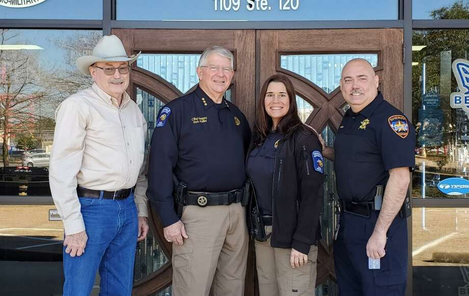 Montgomery County Precinct 1 Constable's Lt. Leslee Zemlicka is the first recipient of the Back the Blue program. From left to right, Texas Top Cop Shop owner Steve Schneider, Pct. 1 Chief Don Fullen, Zemlicka and Multi-County Crime Stoppers Coordinator Steve Squier. Photo: Courtesy Of The Multi-County Crime Stoppers
