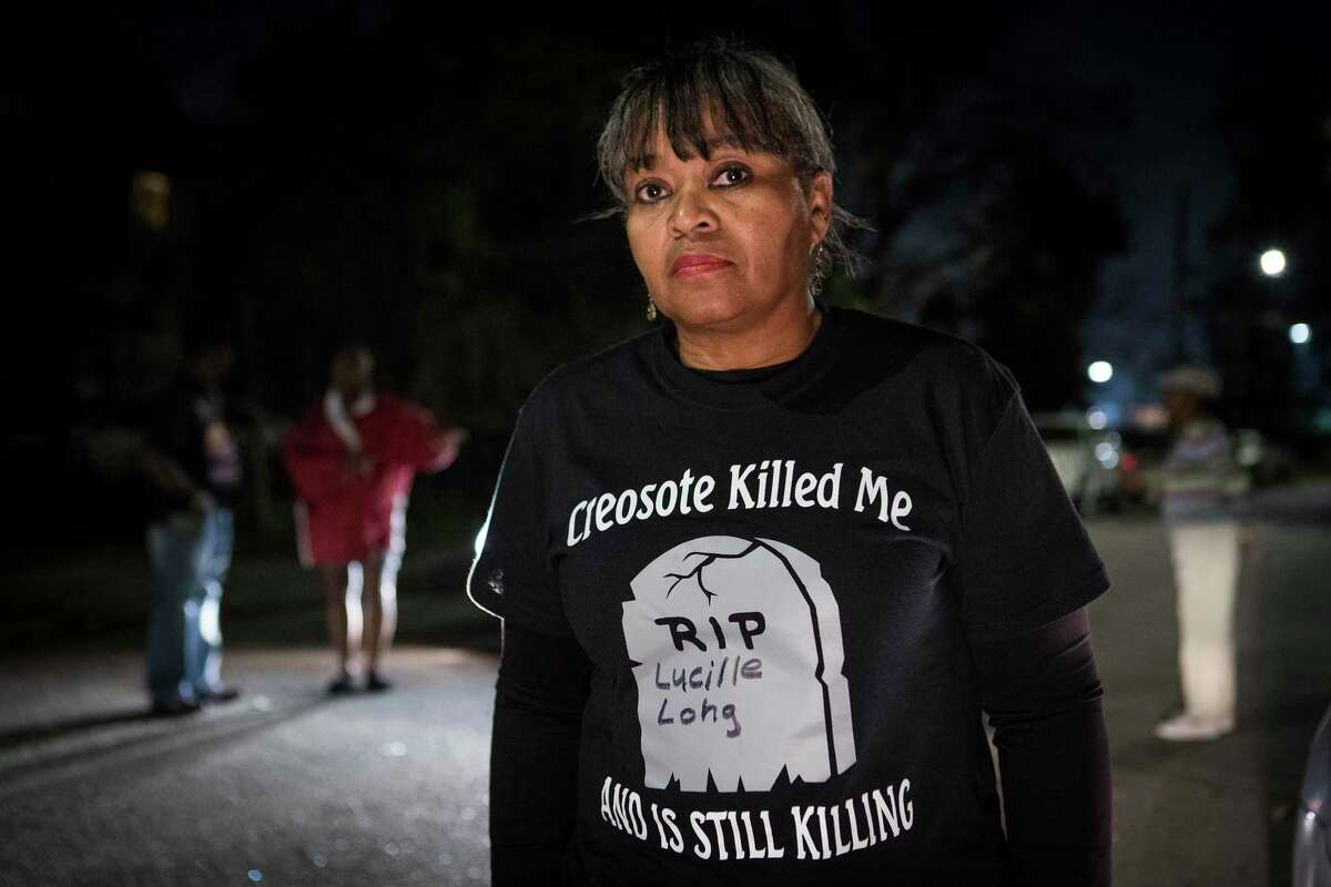 Leisa Glenn stands in their Fifth Ward neighborhood on Thursday, Dec. 5, 2019, in Houston. A cancer cluster was identified in the the historically black north Houston neighborhoods of the Fifth Ward and Kashmere Gardens, near a site of legacy contamination from rail yard operations. Creosote was used for decades to treat wooden railroad ties in the yard. Though wood treatment has ceased for many years, the creosote sunk deep into the ground, creating a plume that has moved beneath an estimated 110 homes. The cancers identified in the cluster are associated with the contaminants found in creosote.