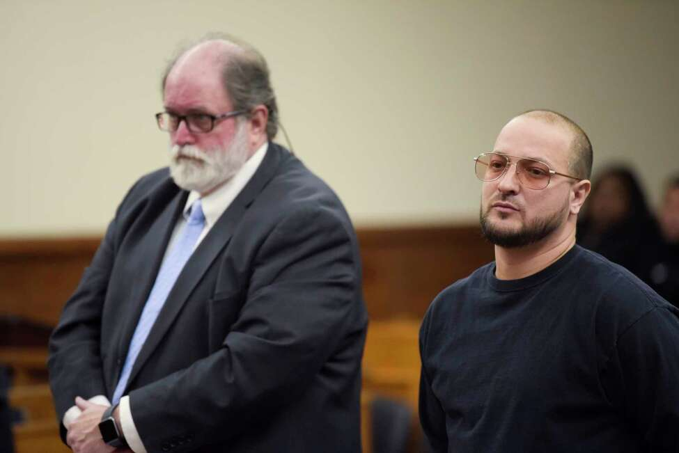 Attorney Mike McDermott, left, and his client, Jason Sellie appear in Schenectady County court for Sellie's sentencing on Tuesday, Feb. 25, 2020, in Schenectady, N.Y. Sellie was sentenced after admitting to shooting a teenager who was one of the gunman who fatally shot his stepdaughter, Ayanna Hunter, after she fired at them first at cookout on Memorial Day in Niskayuna. (Paul Buckowski/Times Union)