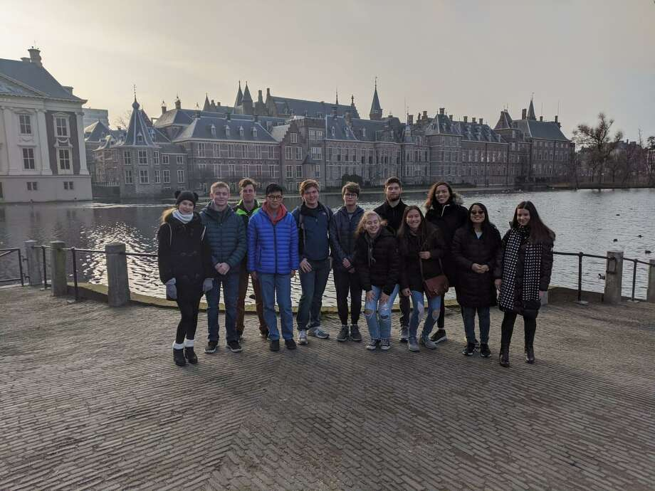The New Canaan High School students who attended the International Model United Nations conference in The Hague were from left to right Helen Culpepper, Aidan Smith, Dan Tierney, Andrew Zuo, Peter Mason, Garrett Ladley, Hannah Swimm, Andrew Morse, Valentina Zamora, Alexa Madrid, Elizabeth Dolan and Isabelle Fernandez. They were in the Netherlands in January 2020. Photo: New Canaan High School / Contributed Photo