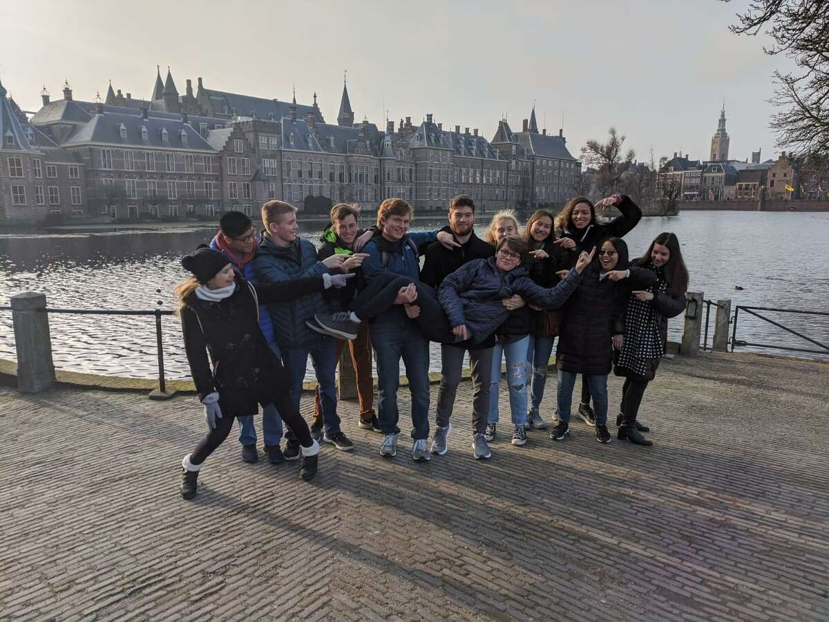 The New Canaan High School students who attended the International Model United Nations conference in The Hague were from left to right Helen Culpepper, Aidan Smith, Dan Tierney, Andrew Zuo, Peter Mason, Garrett Ladley, Hannah Swimm, Andrew Morse, Valentina Zamora, Alexa Madrid, Elizabeth Dolan and Isabelle Fernandez. They were in the Netherlands in January 2020.