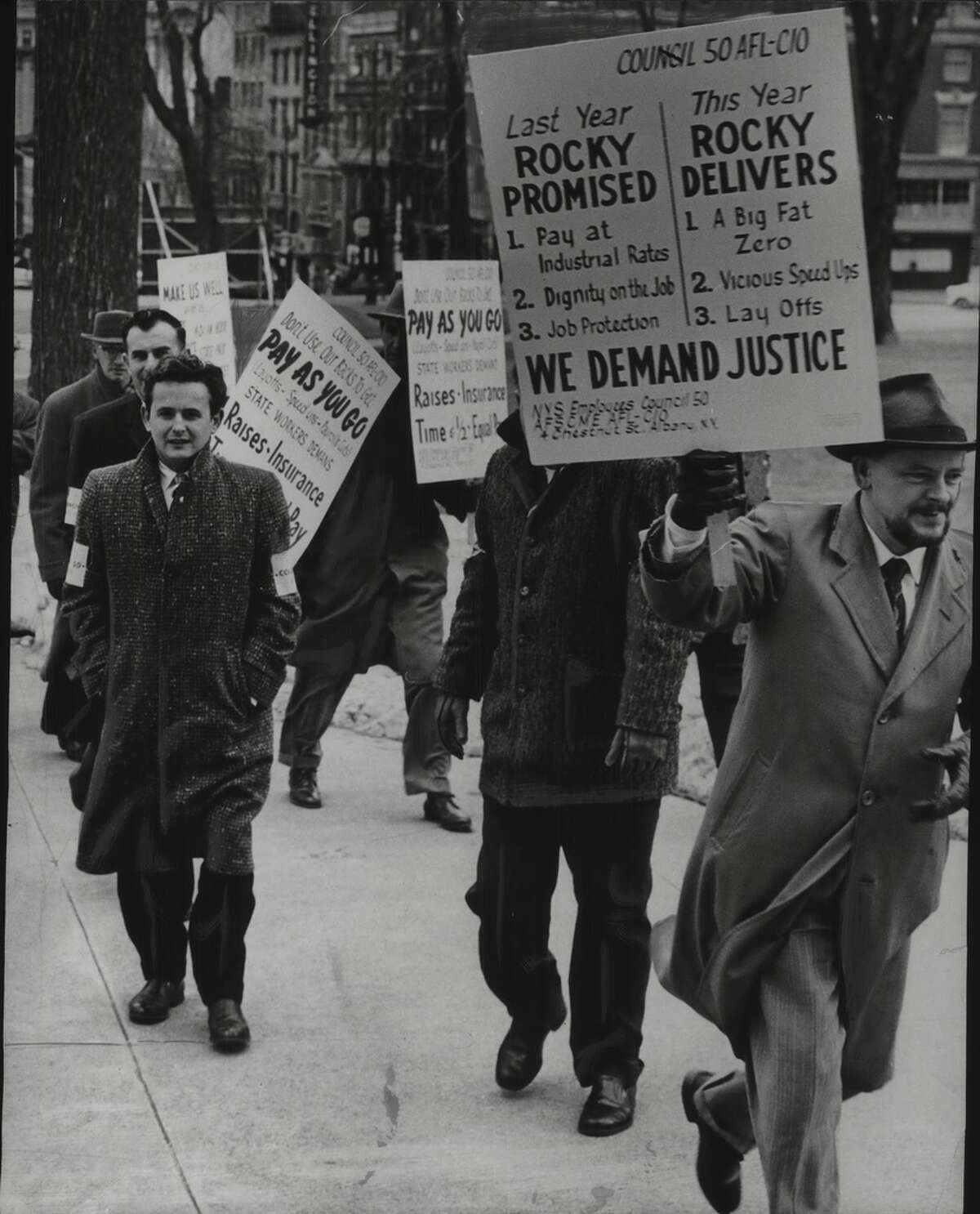 The Members Council 50, American Federation of Labor and Congress of Industrial Organizations (AFL-CIO), Union of State Employees, marches on the Capitol in 1960. The  AFL-CIO describes itself as a federation of 55 national and international labor unions that represent 12.5 million workers.