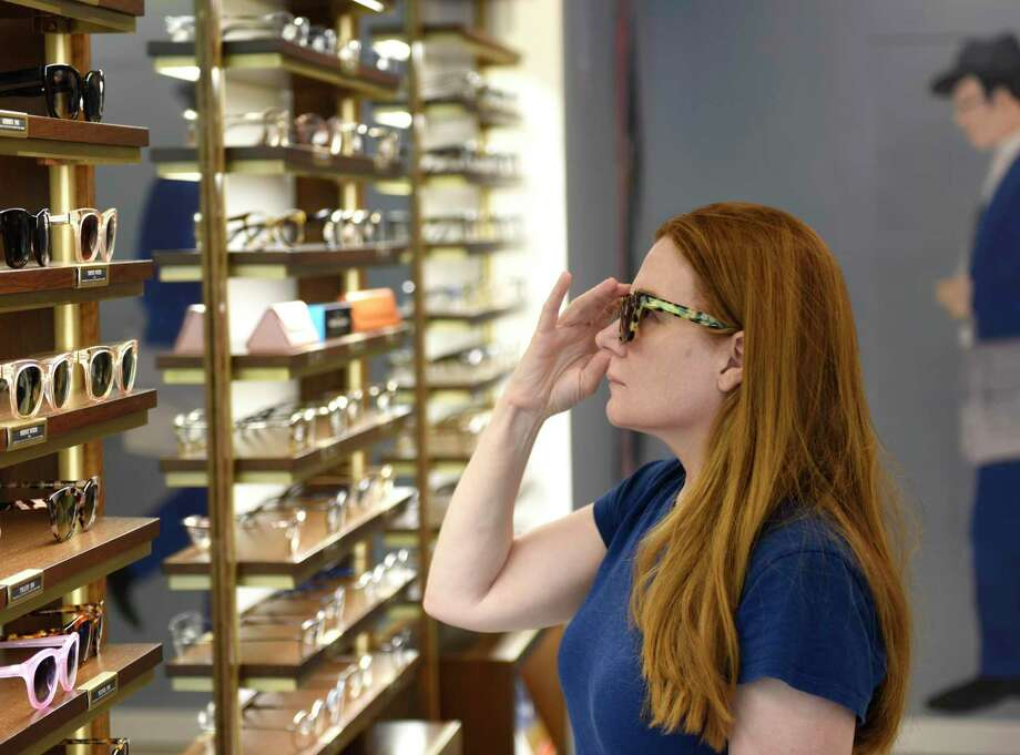 A Darien woman shops in July 2018 at the Warby Parker store in Greenwich, Conn. The retailer adds its second Connecticut location in March 2020 at The SoNo Collection mall in South Norwalk. Photo: Tyler Sizemore / Hearst Connecticut Media / Greenwich Time